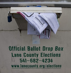 Soaked ballots droop from a locked drop box on Hilyard Street in Eugene on Wednesday, the day after the election. Those turned in past the 8 p.m. deadline weren't counted.