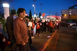 Ethan Frager (hoodie) is a ninth grader at Pioneer Special School in Southeast Portland. He joined a protest Dec. 5, 2017 against a plan to split up the school.