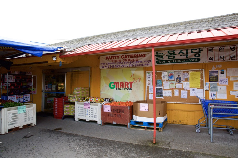 G-Mart, a Korean grocery store in Beaverton, has job postings and flyerswritten in Korean at the front of the store.